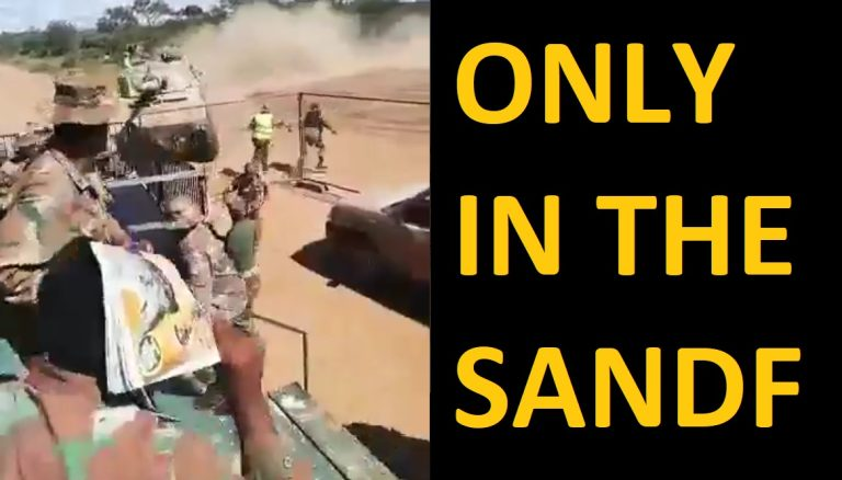 A member of the SANDF unable to get into the back of a truck | South Africa
